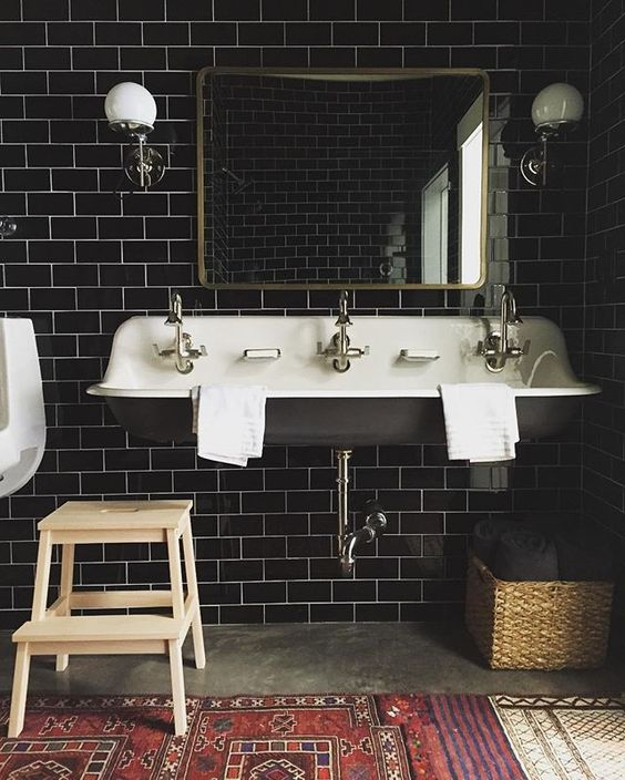 Dark Subway Tile With Schoolhouse Lighting And Cement Floors Give A Fresh Feel To This Farmhouse Bathroom I Love That Sink