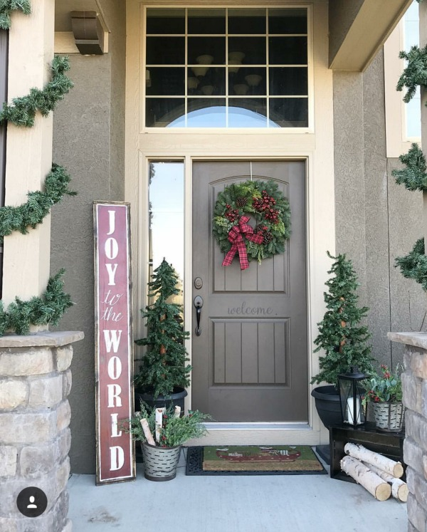 There is no shortage of inspiration for those Christmas Front Porches right here!